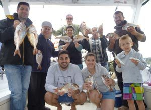 Fishing clients presenting their big catch.
